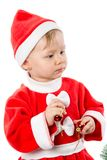 Little child girl in Santa costume on white background. Royalty Free Stock Image