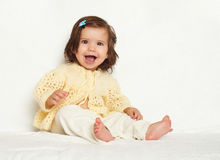 Little child girl sit on white towel, happy emotion and face exp Royalty Free Stock Photos