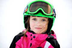 Little child girl in ski helmet and goggles Stock Photos