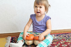 Little child girl smiling with two decorative pumpkins Stock Images