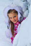 Little child girl in winter clothes with lot of snow. Royalty Free Stock Photo