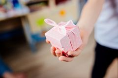 Little child giving present. Royalty Free Stock Photography