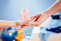 Little child giving present. Royalty Free Stock Images