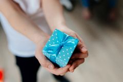 Little child giving present. Stock Images