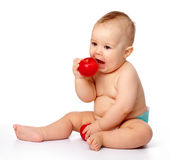 Little child is going to bite red apple Royalty Free Stock Image