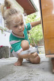 Little child and hammer Stock Image