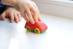 Little child hand close up playing toy Royalty Free Stock Photography