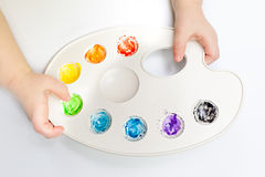 Little child hands holding watercolor palette Royalty Free Stock Photography