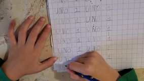 Little child hands writing, top view while doing school homework,education stock footage
