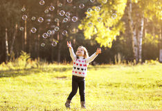 Little child having fun with bubbles soap Stock Photos