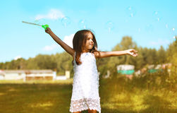 Little child having fun outdoors with soap bubbles Royalty Free Stock Photos