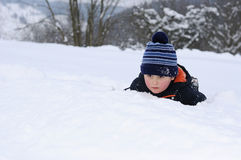 Little child having fun on snow Royalty Free Stock Photography