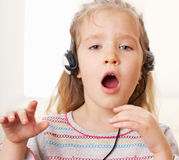 Little child with headphone Stock Image