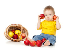 Little Child with healthy food. Child with healthy food apples Royalty Free Stock Photo