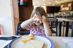 Little child hiding face with ham Royalty Free Stock Images
