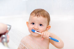 Little child himself brushing his teeth Stock Images