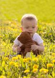 Little child with his teddy bear