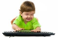 Little child holding keyboard Stock Image