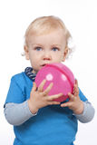 Little child holding a pink ball Royalty Free Stock Image