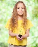 Little child holding a sleedling Royalty Free Stock Photo