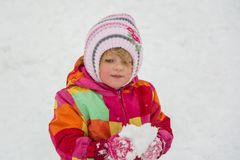 Little child girl with snow in winter stock photo