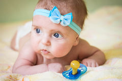 A little child holds a pacifier in his hand Stock Photography