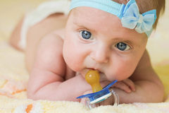 A little child holds a pacifier in his hand Royalty Free Stock Photography