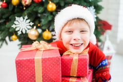 Little child in holiday christmas interior Royalty Free Stock Images