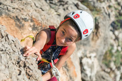 Free Little Child In Protective Helmet Climbing Rock Stock Photos - 89629603