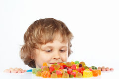 Little child with jelly candies on white background Stock Images