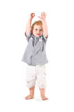 Little child jubilation. Happy beautiful little kid raising arms to celebrate isolated on white background stock photos
