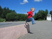 Little child jump long Royalty Free Stock Image
