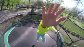 Little child jumping on  trampoline stock video footage