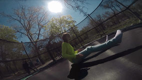 Little child jumping on  trampoline stock footage