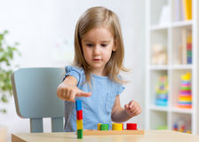 Little child kid playing with building blocks Royalty Free Stock Images
