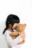 Little child kissing teddy bear Stock Image