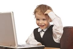 Little child and laptop. Stock Image