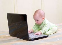 Little child and laptop Stock Image