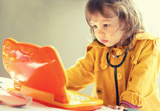 Little child with laptop toy Stock Photography