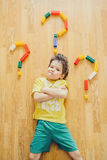 Little child is laying with colorful plastic blocks Stock Photo
