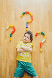 Little child is laying with colorful plastic blocks Royalty Free Stock Photos