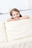Little child leans to the sofa Royalty Free Stock Photo
