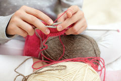 Little child learns to knit. Royalty Free Stock Images