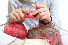 Little child learns to knit. Lifestyle - childhood Stock Image
