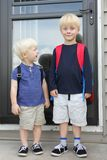 Little Child Looking Up to Big Brother on First Day of School Stock Photography