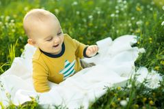 Little child lying on a diaper the grass Royalty Free Stock Photography