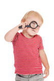 Little child with magnifier on her eye Royalty Free Stock Photo