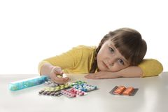 Little child with many different pills on white. Danger of medicament intoxication. Little child with many different pills on white background. Danger of stock photos