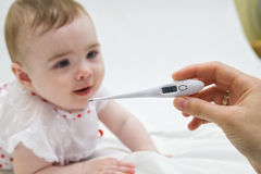 Little child medicine thermometer fever healthcare Royalty Free Stock Image