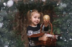 A little child by the New Year tree. Children decorate the Chris. Tmas tree Royalty Free Stock Images